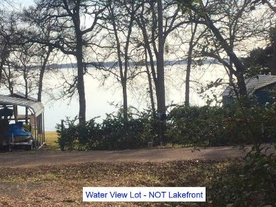 0.90  Acres, 2 wooded off water lots wMetal Bldg., great view of lake