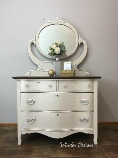 Stunning cream colored dresser with pearl metallic accents