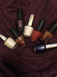 Seven Assorted OPI Nail Lacquers