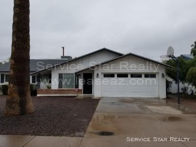 MINUTES FROM ASU - 4 BEDROOM 2 BATH WITH GRASS