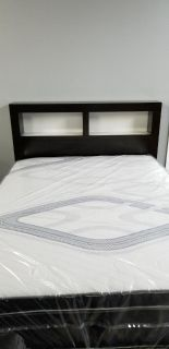 Wood Queen size bed w/shelfs on head board