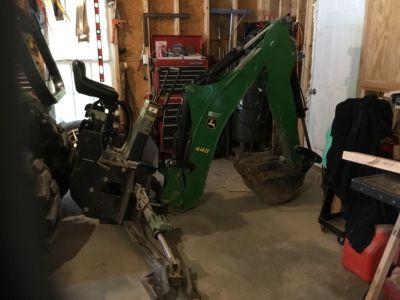 John Deere 448 backhoe attachment
