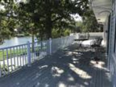 LF Home on 373' Point Lot in Bolliger Creek Cove