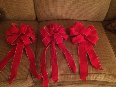 Beautiful red bows trimmed in gold beads