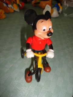 MICKEY WITH CORDED LEGS ON MOVING BIKE