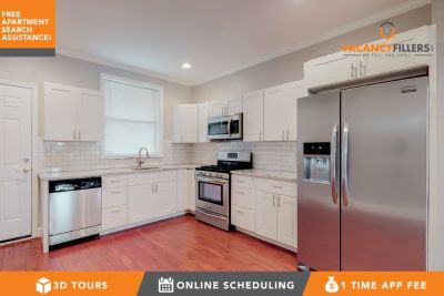 Upscale 2 bed townhouse in Highlandtown w/laundry in unit, parking pad, private deck and more!