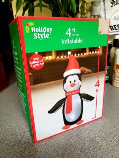4 ft tall. Self Inflatable Merry Christmas Penguin. Lights up. Indoor/outdoor use!