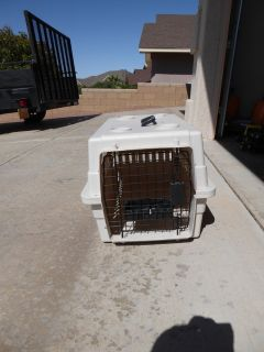 Small dog carriers/kennels