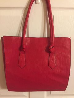 Large fire engine red colored large tote handbag with snap closure. Non smoking. Material inside and out intact. Ppu near White House middle