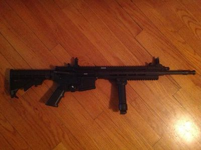 $1,100, Ruger 556 AR-15 piston operated