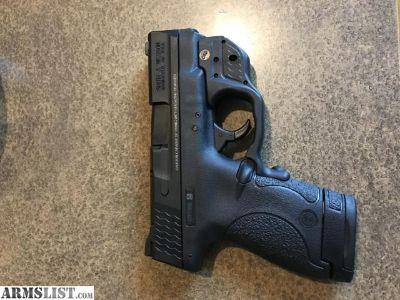 For Sale/Trade: M&p .40 shield w/green crimson trace laser grip