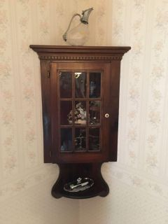 Antique wall mounted corner curio cabinet