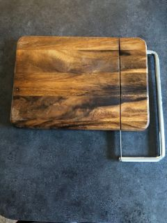 Beautiful wooden cheese board/serving board with built in slicer