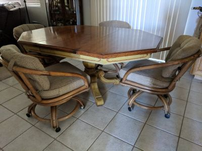 Antique kitchen table and rolling chairs