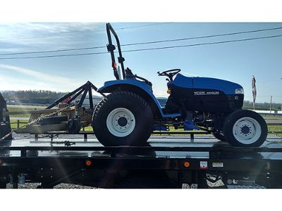TRACTOR TC25 NEW HOLLAND WITH FINISH MOWER, ...