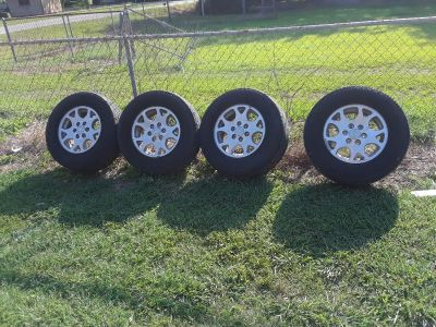 17 inch 6 lug Chevrolet rims and tires Tires are drivable I just got brand new set