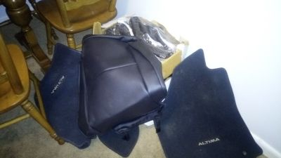 NISSAN SEAT COVERS AND FLOOR MATS