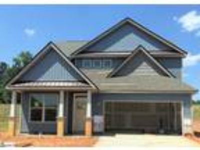 This Three BR 2.5 BA home features Pan Ceiling in...