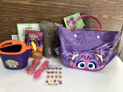 Sesame Street Gardening Kit! Never used, but missing tools. Includes dirt, starter cups, labels & sticks, watering can, tote & instructions