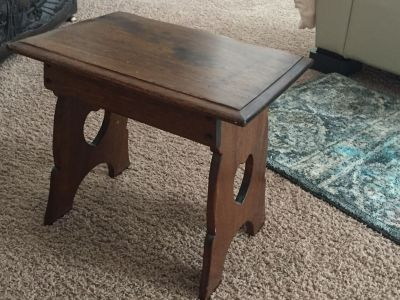 Small antique table with heart cutouts