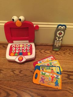Elmo learn and play laptop and Sesame Street remote