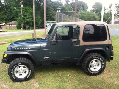 02 Jeep wrangler - 6 cyl5 speedhard top-air cond.