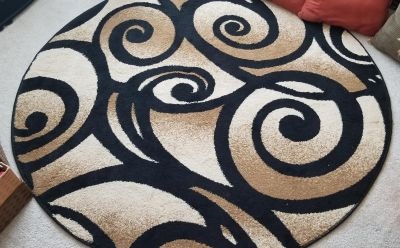 60 inch round area rug. No stains, pet/smoke free home