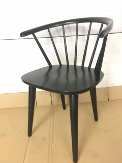 2 black spindle chairs