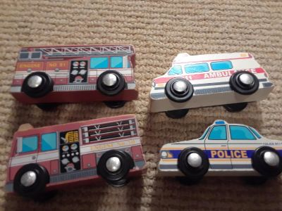 4 wooden emergency vehicles