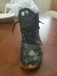High top Under Armour cleats. Size 8 women