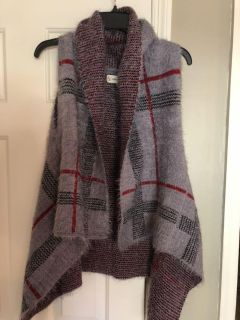 NWOT acrylic/ nylon fuzzy vest. One size fits most. Rep sample. Ppu