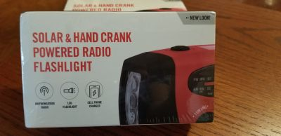 New. Trusty Charge weather radio / flashlight / cell phone charger