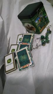 Brand new John Deere stuff to play with...cards, tiny tractor keyrings, and a box to hold it all