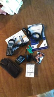 Older cell phone, works needs batteries. Including car charger, books...