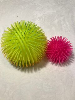 Neon green and pink squishy spike balls