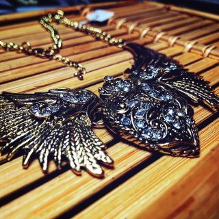 Golden heart and wings necklace