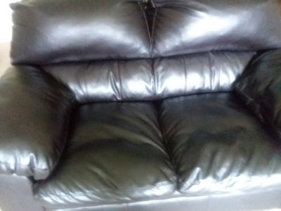 black leather couch and love seat
