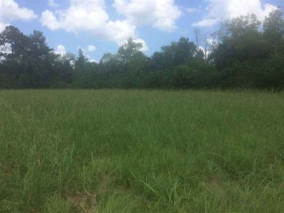 7150 Highway 105 Beaumont, +/- 7.86 Acres Located heavily