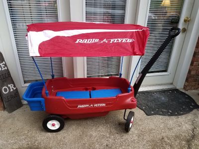Radio Flyer deluxe all terrain wagon with canopy and cargo.
