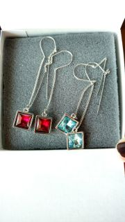 Both sets sold together dangle earrings