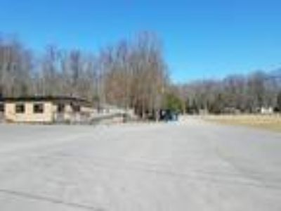 RV/Mobile Home Park, 40-pad with ranch house, and rented tavern, and land.