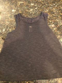 Total girl black tank top with nice back detail . Excellent condition. Size 14 but fits more like a 12z SF. $2