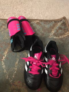 Youth soccer shoes and shin guards