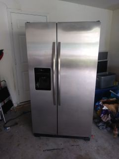 Almost new Side by side stainless fridge