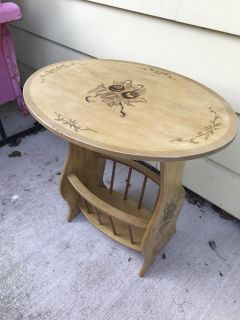 Cute small end table with basket on bottom