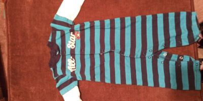 Long sleeve 12-month onesie. Navy and aqua striped with white sleeves