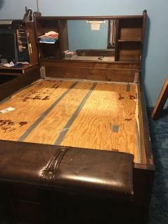 Water bed without mattress. Lots of storage on head board book shelf and underneath frame. A queen size mattress fits inside.