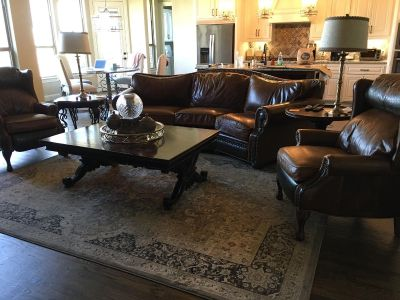 Custom leather sofa and 2 push back recliners $3500