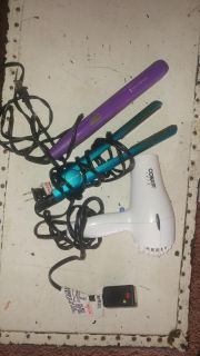 2 hair straighteners and a blow dryer