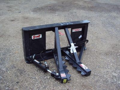 Quick attach tree and post puller for a skid steer or a tractor